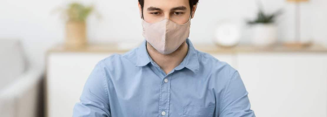 Businessman Working On Laptop Wearing Face Mask Sitting In Office