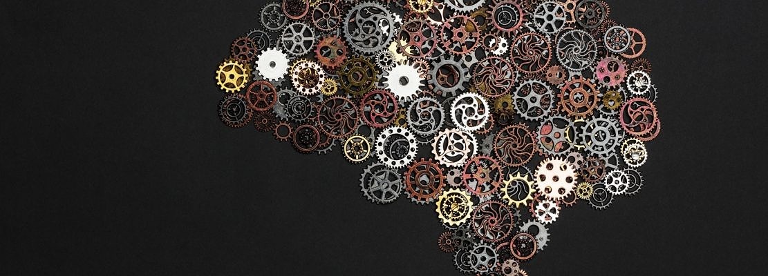 Brain image made out of little cogwheels.