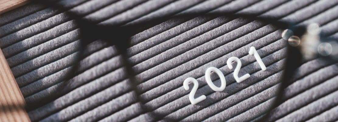 Letterboard with numbers 2021 through eyeglasses. Flat lay concept of 2021 year results. 2021 review
